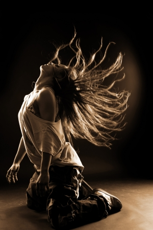 leap: cool woman dancer against black background