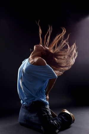 cool woman dancer against black background photo