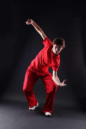 cool man modern dancer against black photo