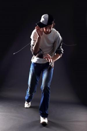 man dancer against black background photo