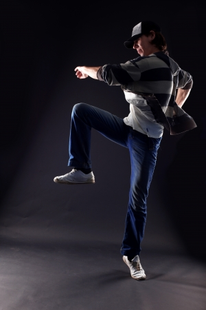 cool man modern dancer against black photo