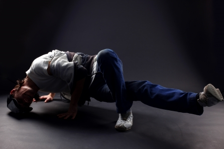 Hip hop man dancer against black background Stock Photo - 15980002