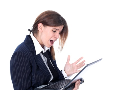 Crisis stressed businesswoman with laptop isolated on white photo