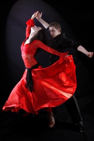 dancers against black background photo