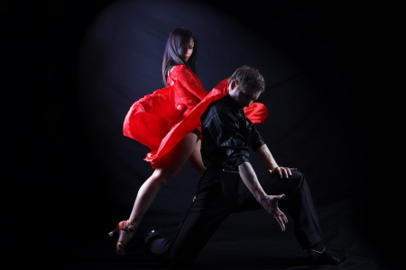 tango dance: dancers in action isolated on white