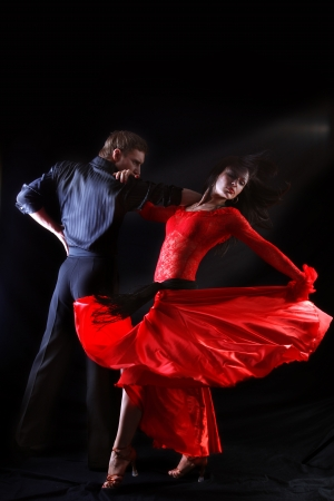 tango dance: dancer in action against black background Stock Photo