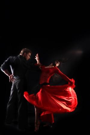 dancer in action against black background Stok Fotoğraf