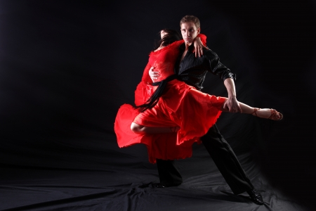 tango dance: dancers in action against black background