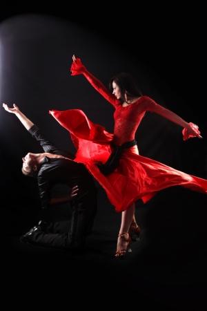 dancer in action against black background photo