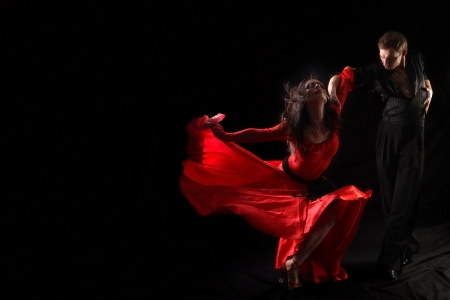 latin girls: dancer in action against black background Stock Photo