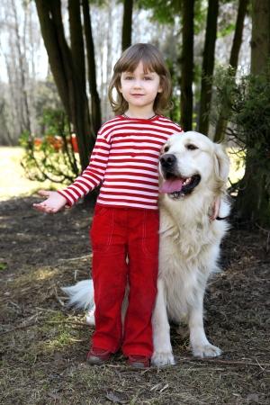 pillowy: friends - little girl with big retriever outdoor