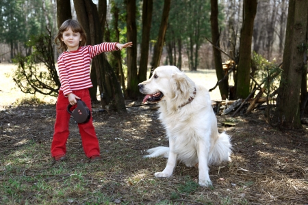 my big friend  - little girl with retriever outdoors Stock Photo - 15980560