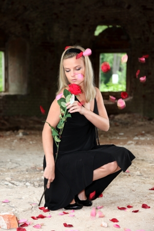 lovely woman with rose under falling petals Stock Photo - 15942270