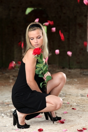 lovely wiman with rose under falling petals Stock Photo - 15980397