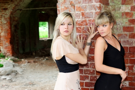 two girls at old brick wall Stock Photo - 15980519