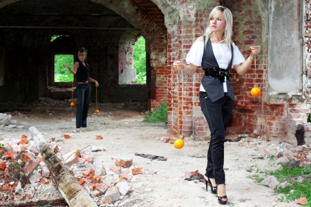 two girls with oranges at old house Stock Photo - 15980555
