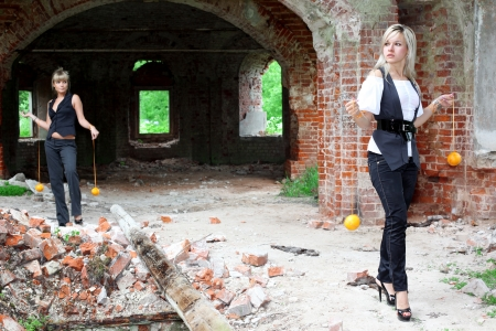 two girls with oranges at old house Stock Photo - 15980563