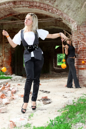 two girls with oranges at old house photo