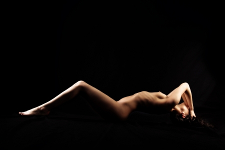 black girl nude: classical nude woman against black background Stock Photo