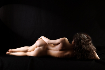 classical nude girl against black background
