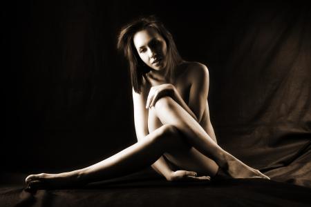 girl sitting against black background Stock Photo - 15949361