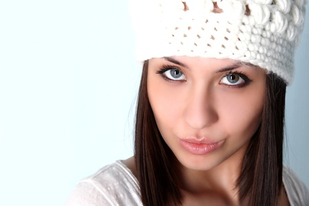 young woman in woolly white hat photo