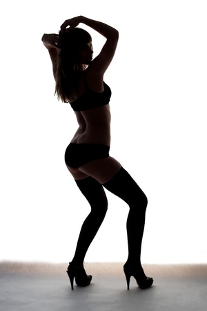 silhouette of young sport girl photo