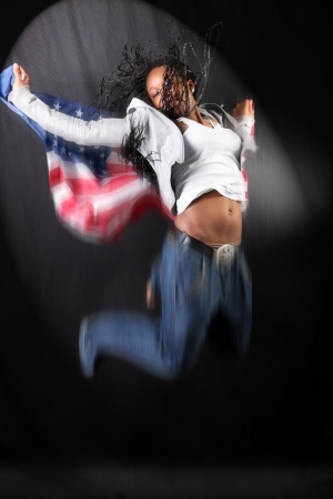 afro-american dancer in jump with USA flag photo