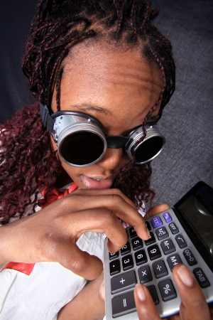 afro american with calculator Stock Photo - 15950285