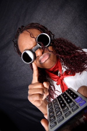 bad news for your business - afro american with calculator  Stock Photo - 15952211