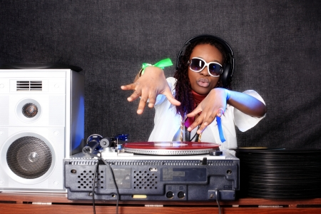 cool afro american DJ in action photo