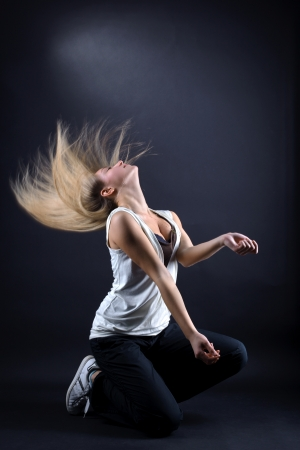 woman modern dancer against black background photo
