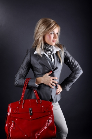 fashion young woman with red bag photo