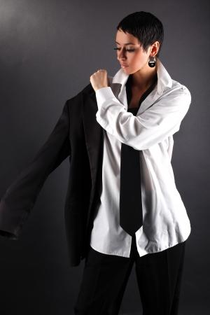 ady: woman with white shirt dressing coat Stock Photo
