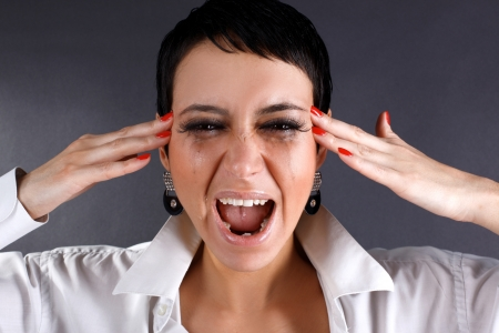 pain and depression - screaming woman with tears photo