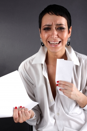 bad news - depression woman with tears holding letter Stock Photo - 15955316