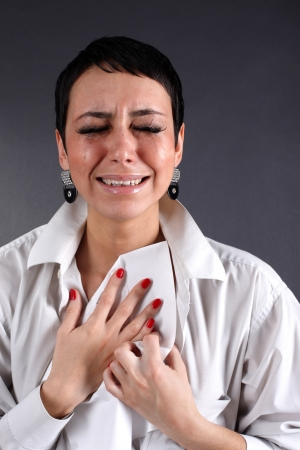 bad news - depression woman with tears holding letter photo