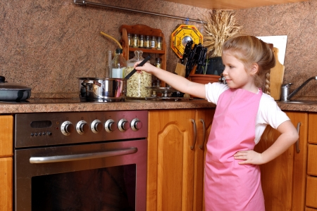 Girl cooking in the Kitchen photo