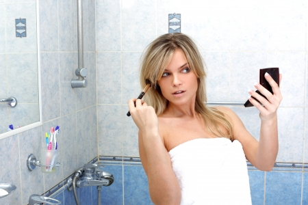 25s: Young woman during daily morning routines