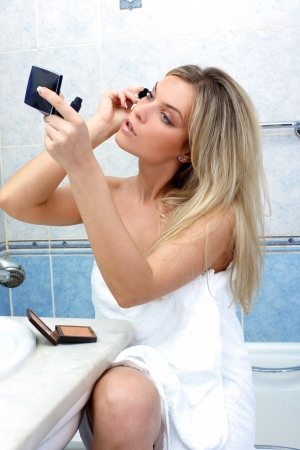 Young woman during daily morning routines Stock Photo - 15959862