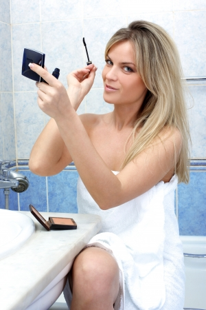 Young woman during daily morning routines Stock Photo - 15959661