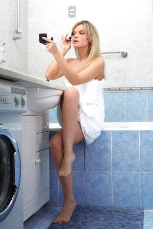 Young woman during daily morning routines photo