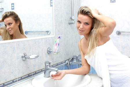 woman washing in the bathroom Stock Photo - 15957941