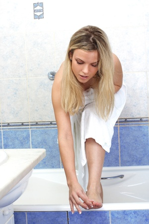 Young woman during daily morning routines Stock Photo - 15955668