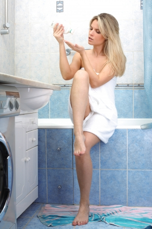 Young woman during daily morning routines Stock Photo - 15960518