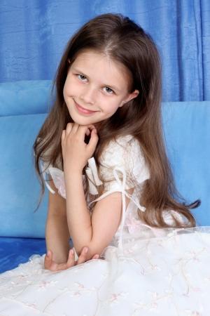 girl room: little girl sitting in sofa