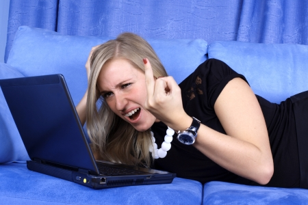 hard day - woman working with PC at home in sofa Stock Photo - 15964159