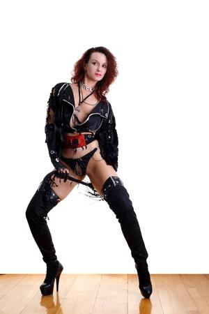 strip dance: modern strip dancer in ballroom against white background