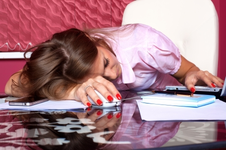 tired woman sleeping at the PC