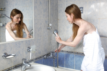 young woman in bathroom take a shower Stock Photo - 15989885